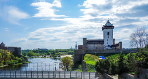 Narva river from Estonian side with flags Stock Photo