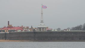 Naryshkin Bastion, Peter and Paul fortress waving on the spire of the red St. Andrew`s Huis flag, sea fortress, autumn day. A Naryshkin Bastion, Peter and Paul stock video footage