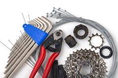Narzędzia dla bicykl naprawy Na biały tle Wewnętrzny przekładnia kabel, nippers, kaseta Zdjęcie Stock