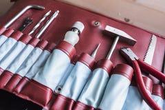 Narzędzia w czerwonej rzemiennej skrzynce Zdjęcia Royalty Free