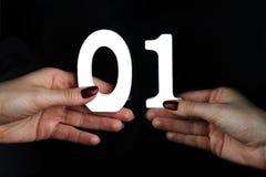 Nas palmas do dígito um e zero imagens de stock