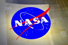 NASA insignia. Cape Canavera, Florida, USA - May 6, 2015: NASA insignia printed on the outside of the Space Shuttle tiles Royalty Free Stock Photos