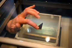 Nasa museum moon rock. One of the tourists touching moon rock at NASA museum - Florida Royalty Free Stock Photo