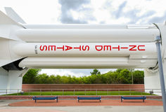 Nasa Saturn IB Rocket. Benches under lower booster stage of the Saturn IB Rocket on display in Goddard Rocket Garden at Kennedy Space Center, Cape Canaveral Royalty Free Stock Photo