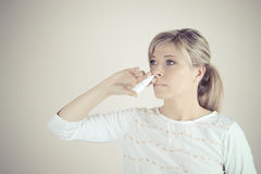 Nasal Spray. Closeup Of Beautiful Young Woman`s Face With Nasal Drops Stock Images