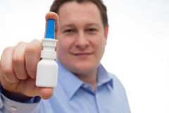 Nasal spray man Stock Images