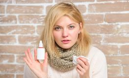 Nasal spray runny nose remedy. Girl sick person hold nasal drops and tissue. Allergy concept. Home treatment. Nasal. Drops plastic bottle. Effective nasal spray royalty free stock photography