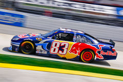 NASCAR 10 - Red Bull Fast!. NASCAR driver Brain Vickers and his #83 Red Bull Toyota speeds into Turn 3 at Martinsville Speedway during the 2010 Goody's 500 in stock images