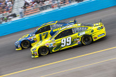 NASCAR 2013:  Sprint Cup Series Subway Fresh Fit 500 MAR 03. AVONDALE, AZ - MAR 03, 2013:  Ricky Stenhouse, Jr. (17) and Carl Edwards (99) battle for position Royalty Free Stock Photo