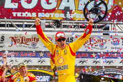 NASCAR: Apr 07 Duck Commander 500. Fort Worth, TX - Apr 07, 2014: Joey Lagano (22) wins the Duck Commander 500 at Texas Motor Speedway in Fort Worth, TX royalty free stock image