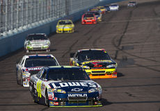 NASCAR: April 10 Subway Fresh Fit 600. AVONDALE, AZ - Apr 10: Jimmie Johnson heads to turn one for the running of the Subway Fresh Fit 600 race at the Phoenix stock photos