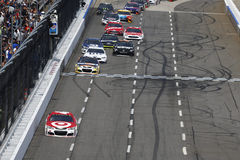 NASCAR: April 02 STP 500. April 02, 2017 - Martinsville, Virginia, USA: Kyle Larson 42 leads the field to turn one during the STP 500 at Martinsville Speedway in Royalty Free Stock Photos