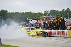 NASCAR:  Aug 29 Road America 180 Fired up by Johnsonville. Elkhart Lake, WI - Aug 29, 2015:  Paul Menard (33) celebrates with a burnout after winning the Road Royalty Free Stock Photography