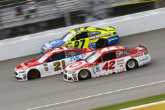NASCAR: August 13 Pure Michigan 400. August 13, 2017 - Brooklyn, Michigan, USA: Kyle Larson 42, Ryan Blaney 21 and Paul Menard 27 battle for position during the Stock Photo