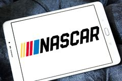 NASCAR Auto racing logo. Logo of NASCAR Auto racing on samsung tablet. National Association for Stock Car Auto Racing NASCAR is an American auto racing royalty free stock photography