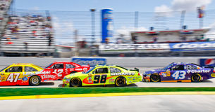 NASCAR Bumper to Bumper in Turn 3! Royalty Free Stock Images