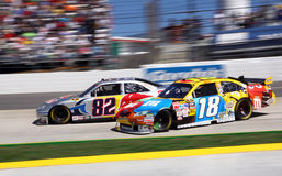 NASCAR - Busch gets loose and crashes. NASCAR driver Kyle Busch's #18 M&M's Toyota gets loose in Turn 3, narrowly avoiding the#82 Red Bull car driven by Scott Stock Images