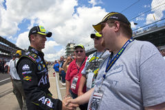 NASCAR:  Carl Edwards Allstate 400. 25 July, 2009:  Carl Edwards takes time out to talk to fans before qualifying for the Allstate 400 at the Brickyard race in Stock Photos