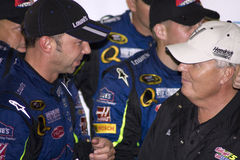 NASCAR Chad Knaus and Rick Hendrick. NASCAR Cup crew chief Chad Knaus and team owner Rick Hendrick congratulate each other moving one race closer to winning Royalty Free Stock Photography