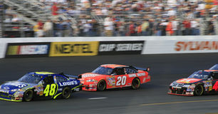 NASCAR - Champions Battle in N. Juan Pablo Montoya tries in vain to catch former NASCAR champions Jimmie Johnson and Tony Stewart during the first race of the Royalty Free Stock Photo