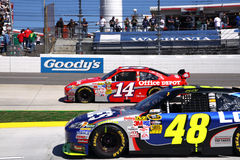 NASCAR - Champions Race Martinsville. NASCAR driver and 3 time defending champion Jimmie Johnson's #48 Lowes Chevy pulls onto pit road while 2 time champion Tony Stock Photos