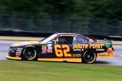 NASCAR-chaufför Brendan Gaughan på spåret Fotografering för Bildbyråer