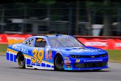 NASCAR-chaufför Ryan Sieg på trottoaren Arkivfoton
