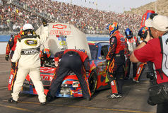 NASCAR Cup driver Jeff Gordon engine problems. NASCAR Sprint cup driver Jeff Gordon sits on pit road while his crew tries to find the source of engine problems Royalty Free Stock Photography