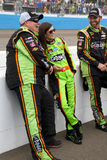 NASCAR Danica Patrick at Phoenix International Raceway. Danica Patrick leans against the pit wall with the boys Royalty Free Stock Photography