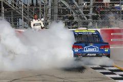 NASCAR: Drev för Juni 04 amerikanska motorförbundet 400 för autism Royaltyfria Bilder