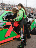 NASCAR Driver Danica Patrick. NASCAR female race car driver Danica Patrick preparing to enter her race car prior to racing Royalty Free Stock Images
