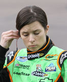 NASCAR Driver Danica Patrick. NASCAR female race car driver Danica Patrick inserting ear phone prior to NASCAR Nationwide series race Stock Photos