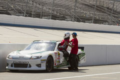 Nascar driver entering car on pit row Stock Photo