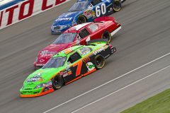NASCAR:  February 20 Stater Bros 300. Fontana, CA - February 20, 2010:  Danica Patrick makes it three wide with James Buescher, and Carl Edwards during the Royalty Free Stock Photography
