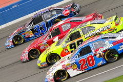NASCAR:  February 20 Stater Bros 300. Fontana, CA - February 20, 2010:  Kevin Harvick, James Buescher, Paul Menard and Joey Logano make it four wide through the Royalty Free Stock Photos