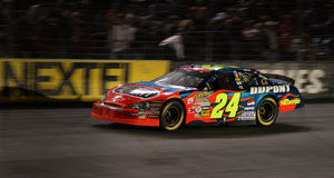 NASCAR - Jeff Gordon flies by. Jeff Gordon's #24 Dupont Chevy streaks by fans during the NASCAR Bank of America 500 during the 2006 Chase for the NASCAR Nextel Stock Photography