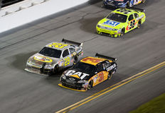 NASCAR:  July 04 Coke Zero. 04 July, 2009:  Teamates, Jeff Burton and Kevin Harvick, battle for position off turn 4 during the running of the Coke Zero 400 Royalty Free Stock Image
