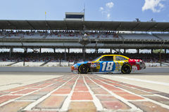 NASCAR: JULY 23 Brickyard 400. INDIANAPOLIS, IN - JULY 23, 2010: Kyle Busch brings his M&M's Toyota across the bricks during a practice session for the Brickyard stock photography