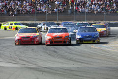 NASCAR:  June 21 Toyota/SaveMart 350. 21 June, 2009:  Marcus Ambrose,  Joey Logano, and Scott Speed make it three wide after coming off turn 7 at the Toyota/Save Stock Photo