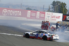 NASCAR: June 25 Toyota/Save Mart 350. June 25, 2017 - Sonoma, CA, USA: Kevin Harvick 4 does a burnout in front of his crew after he wins the Toyota/Save Mart 350 Royalty Free Stock Photography