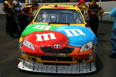 NASCAR - Kyle Busch #18 M&Ms. Ky;e Busch's #18 M&Ms Toyota Car of Tomorrow post final inspection before the 2008 Coca Cola 600 at Lowes Motor Speedway Royalty Free Stock Images