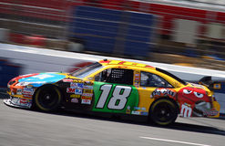 NASCAR - Kyle Busch in Action. Ky;e Busch's #18 M&Ms Toyota Car of Tomorrow practices before the 2008 Coca Cola 600 at Lowes Motor Speedway Royalty Free Stock Photo