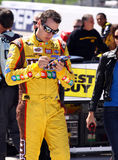 NASCAR - Kyle Busch Autographs a Souvenir Royalty Free Stock Photo