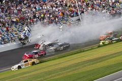 NASCAR: Kyle Larson wrecks at daytona. Daytona Beach, FL - Feb 23, 2013: A huge wreck involving Kyle Larson occurs during the finish of the DRIVE4 COPD 300 at royalty free stock photo
