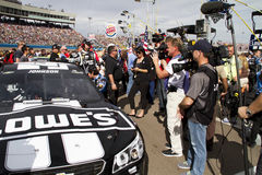 NASCAR Lowe's Chevy of Jimmie Johnson at Phoenix International Raceway. Media and fans surround the car of Jimmie Johnson Royalty Free Stock Photography