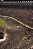 NASCAR - Lowes Motor Speedway. A view of cars exiting turn 4 headed for the front stretch during the Bank of America 500, October 2007 at Lowes Motor Speedway in royalty free stock photography