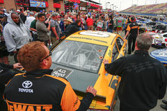 NASCAR:  Mar 22 Auto Club 400. Fontana, CA - Mar 22, 2015:  The DeWalt crew push their Toyota Camry to the grid before the start of the Auto Club 400 at Auto Royalty Free Stock Image