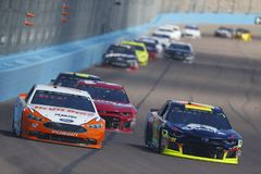 NASCAR: March 11 Ticket Guardian 500k. March 11, 2018 - Avondale, Arizona, USA: William Byron 24 brings his car down the front stretch for the Ticket Guardian royalty free stock image