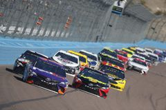 NASCAR: March 11 Ticket Guardian 500k. March 11, 2018 - Avondale, Arizona, USA: Denny Hamlin 11 brings his car down the front stretch for the Ticket Guardian royalty free stock images