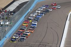 NASCAR: March 11 Ticket Guardian 500k. March 11, 2018 - Avondale, Arizona, USA: William Byron 24 brings his car down the front stretch for the Ticket Guardian royalty free stock photography
